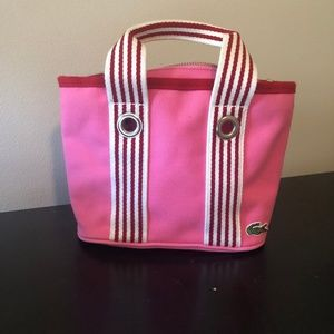 Lacoste. Small pink bucket bag.